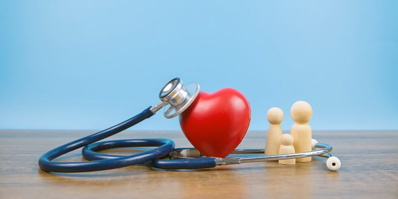 close-up-a-red-heart-shape-and-medical-stethoscope-with-family-the-picture