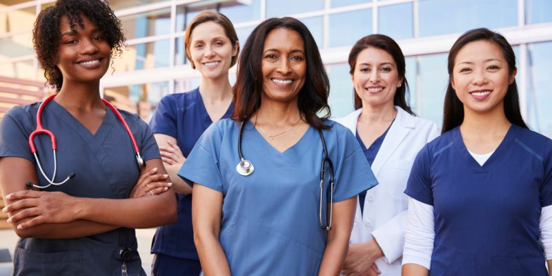 Group of Diverse Female Nurses in front of Office