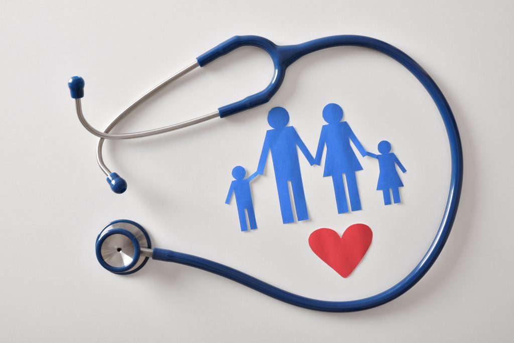 Concept of family medicine with ostetoscope and paper cut